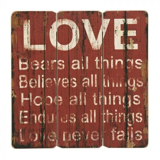Love never fails træ skilt. Flot retro træskilt med tekst om kærlighed.