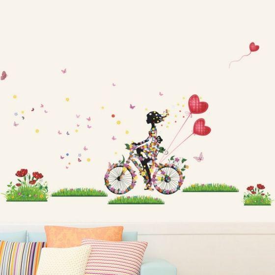 Pige på cykel wall sticker. Flot vægklistermærke med dame, hjerter og blomster