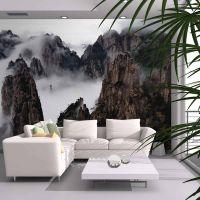 Bjergkæde dækket af et hav af skyer fotostat - flot foto tapet til væggen