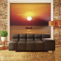 Solnedgang over fiskernes båd fotostat - flot foto tapet til væggen