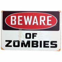 Beware of zombies. Flot retro blikskilt med tekst med pas på zombier.