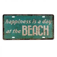 Happiness is a day at the beach Metal skilt. Flot retro blikskilt med tekst om lykke på stranden.